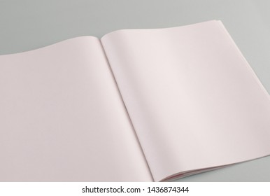 Perspective blank photo illustration opened magazine mock-up. Magazine opened pages template against a gray background isolated. Top view.