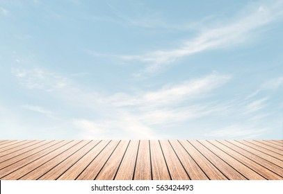 Perspective border wood table beach outside on calm blue sky in spring background concept for wide dinning board on summer landscape wallpaper bacground, mockup promotion product.