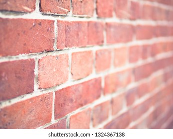 Perspective brick wall with selective focus for pattern and background