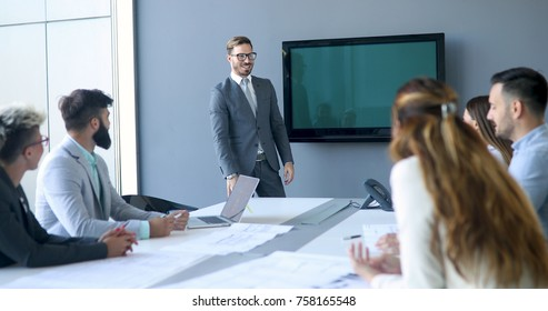 Perspective businesspeople having meeting in conference room