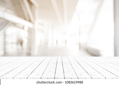 Perspective empty white wooden table on top over blur background, can be used mock up for montage products display or design layout.