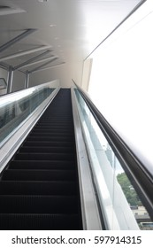 perspective escalator to up floor with rail for hands and outside background