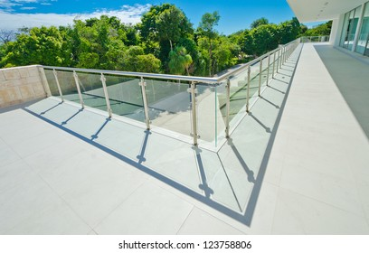 Perspective of the modern glass and steel balcony, deck railing. Exterior, interior design.