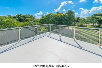 Perspective of the modern glass and steel balcony, deck, patio, promenade railing. Exterior, interior design.
