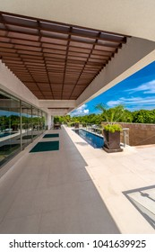 Perspective, outlook at the modern building balcony, deck, patio of the restaurant, cafe, bar of the luxury tropical resort. Exterior, interior design.