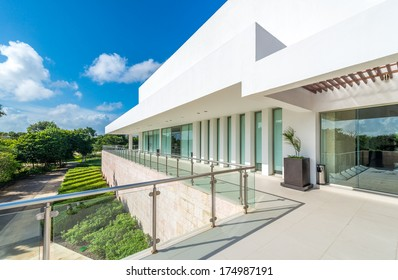 Perspective, panorama at the modern glass and steel balcony, deck, promenade with glass and steel railing. Exterior, interior design.