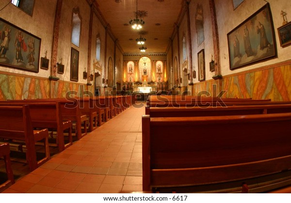 perspective of pews before an alter