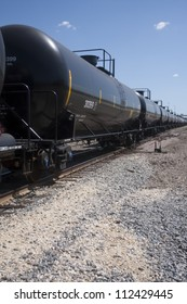 Perspective of rail tanker cars on train tracks