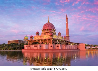 A perspective shot of the beautiful and colourful Putra Mosque which stands as the major landmark by Putrajaya Lake in Precinct 2, Putrajaya, Malaysia