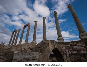 A perspective shot of a series of ruined columns of Smyrna's ancient agora in Izmir Agora, Turkey