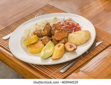 Perspective top view shot of traditional ecuadorian mountain range food on wood table