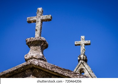 Perspective of two crosses of a chapel in a small abandoned village in Galicia. Northern Spain