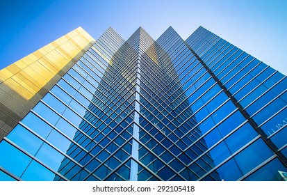 Perspective and underside angle view to textured background of modern glass  blue building skyscrapers roof