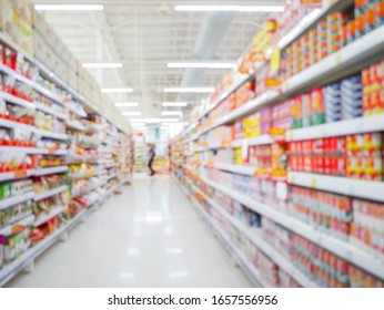 Perspective view, Abstract concept blurred colorful background, Customer shopping several consumer good on shelves between corridor with clear light in convenience supermarket and minimart