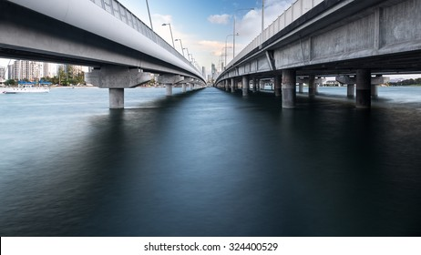 Perspective View Below the Southport Sundale Bridge During The Evening And Overlooking The Gold Coast City Skyline, Nerang River, Queensland, Australia