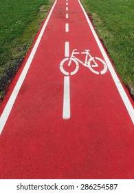 Perspective view of a bike path in synthetic red rubber