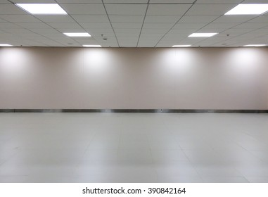 Perspective view of Empty Space Classic White Office Room with Row of Ceiling LED Light Lamps and Lights Shade on The Wall for Gallery Interior / Use as Template to Mock Up or Display Office Furniture