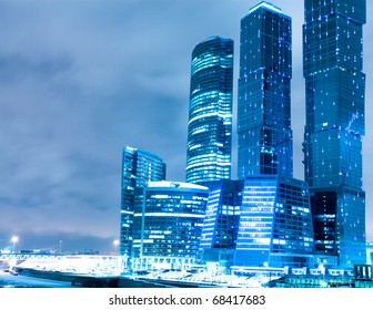 perspective view to glass high-rise building skyscrapers at night