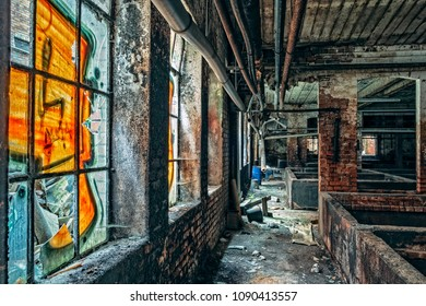 Perspective view of industrial ruin interior with its sprayed windows