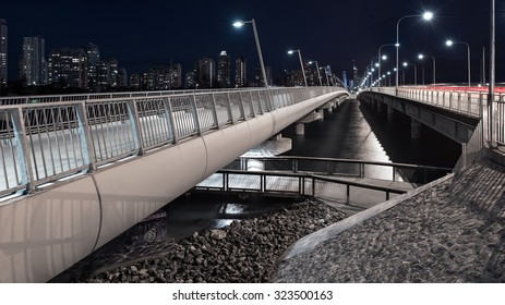 Perspective View of a Modern Architectural Concrete Highway Bridge Over a River at Night With Street Lights Overlooking The Gold Coast City Skyline, Sundale, Southport, Queensland, Australia