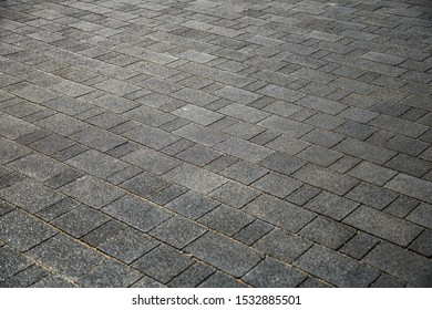 Perspective View of Monotone Gray Brick Stone on The Ground for Street Road. Sidewalk, Driveway, Pavers, Pavement in Vintage Design Flooring Square Pattern Texture Background,Floor tiles texture