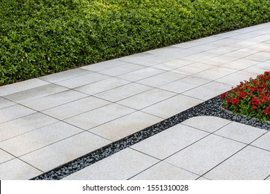 Perspective View Monotone Gray Brick Stone Pavement on The Ground for Street Road. Sidewalk Driveway Pavers green grass