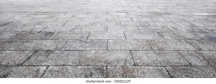 Perspective View of Monotone Gray Brick Stone on The Ground for Street Road. Sidewalk, Driveway, Pavers, Pavement in Vintage Design Flooring Square Pattern Texture Background