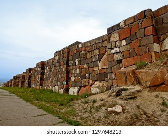 Perspective view on the exterior walls of the ancient urartian fortress Erebuni, one of the oldest strongholds in the world, it founded in 782 BC, Yerevan, Armenia
