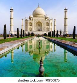 A perspective view on Taj-Mahal mausoleum with reflection in water.