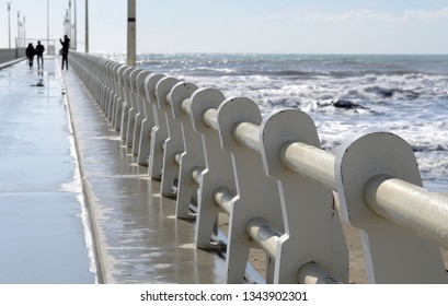 perspective view of a pier in the Versilia coastline on a sunny winter day