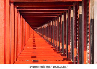 Perspective view of the red beach huts. Infinite background. The cabins on the beach in succession form a regular pattern projected to infinity. Endless.