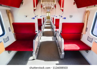 Perspective view of red seat in the train with light and shadow from the outside