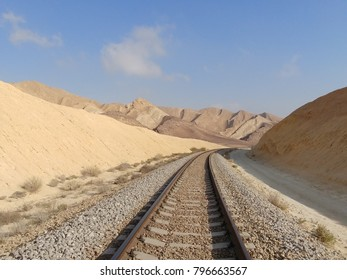 Perspective view of remote railroad in Negev desert, Israel.