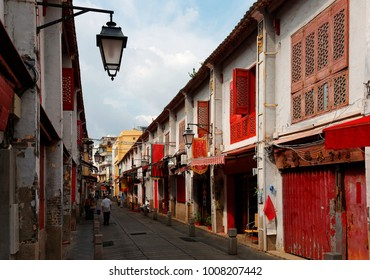 Perspective view of the Street of Happiness (Rua da Felicidade) flanked by traditional Chinese houses with conspicuous red doors and windows in Macau, China This is a bygone Red Light district