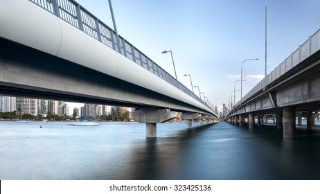 Perspective View Under the Southport Sundale Concrete Bridge During The Day Overlooking The Gold Coast Tourism Skyline, Nerang River, Queensland, Australia