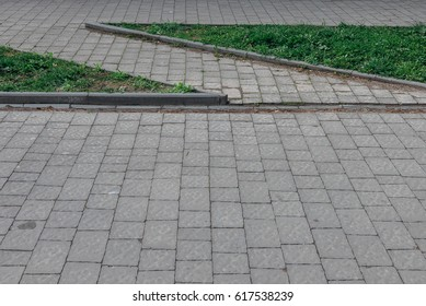 Perspective View of Various Color Grunge Brick Stone on The Ground for Street Road. Sidewalk, Driveway, Pavers Flooring Hexagon Pattern Texture Background, Bench around pavers grass