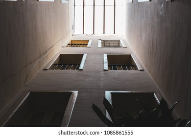 A perspective view of window sills from bottom to top. Iron railings, wooden windows and glass to the attic, in old apartments in the city.