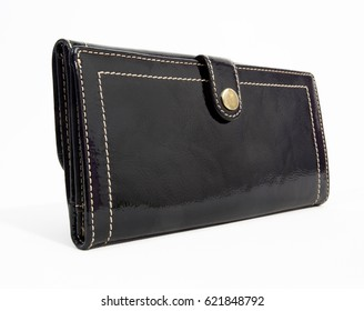 Perspective view of woman's black wallet with clasp. Isolated.