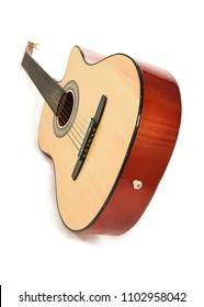 Perspective view of wooden acoustic guitar with body facing towards the front and neck blurring slightly into the background. White backdrop with shadow.