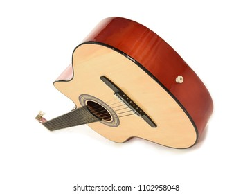 Perspective view of Wooden acoustic guitar tilting forward on a white background with space for text.