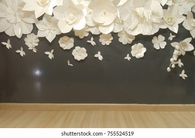 Perspective view of wooden panel and beautiful group of handmade quilling 3D flower paper, floral pattern on black wall background vintage interior banner