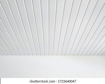 Perspective of white wood sheeting ceiling and smooth white wall in Caribbean construction. White ceiling beams pattern background.