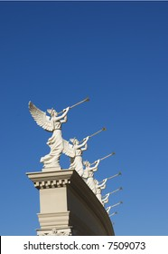 Perspective of winged trumpeters with golden trumpets