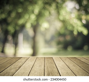 Perspective wood with blur landscape background