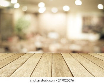 Perspective wood and blurred cafe with bokeh light background. product display template