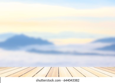 Perspective wood deck overlook the mountains  background atmosphere as the sun sets. Services include product display  template