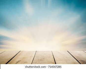Perspective wood floor brown color texture with beautiful nature background. Abstract simple hardwood photography light gradient wallpaper concept for product montage mockup regular beach sand scene.