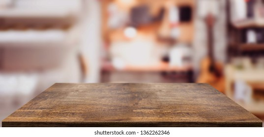 Perspective wood table counter in home office.Empty wooden tabletop with blurred music workplace background.Mock up template for display or montage of your design,Banner for advertise of product.