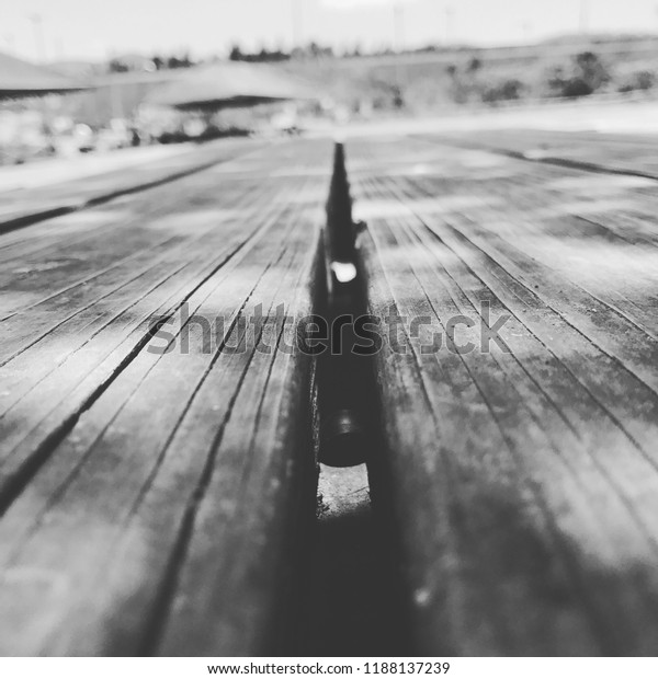 Perspective wood table at the park