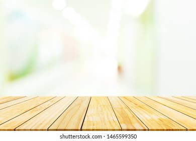 Perspective of wooden board empty table top on of blurred  background.Free space for montage your product or design.